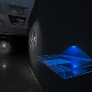 """artists handwriting in plexiglass box, the text """"…I continue; at some point the battle of objective reality and my subjective experience comes to an end, and the residues in the potential state of material become the narrator, not as a real storyteller, but as something that is positioned in the place of a narrator. more than narrating themselves for others, the residues lay themselves bare vis-à-vis their own selves. everything is imperfect and only absence can fill the empty place."""""""