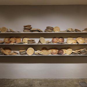 installation of 700 plates wooden shelves, bread dough,variationof1000-1699