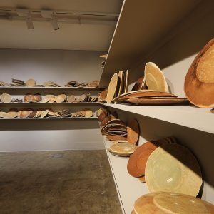 installation of 700 plates made of bread/ wooden shelves, bread dough,variation of 1000-1699