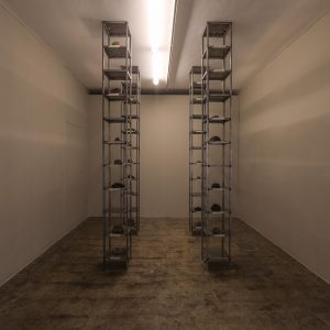 installation view/ installation made of thirty-five thousand date kernel in 4 metal columns consists of 10 shelves, processed by turmeric,mold,oil,and soot